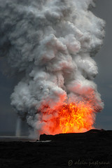 lavaburst (alvin pastrana) Tags: ocean orange clouds volcano hawaii lava coast smoke explosion cliffs 2008 billow waterspout plume natureoutpost alvinpastrana