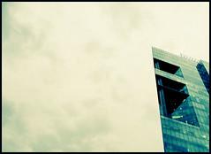 Oil Fount. (Bitten Apple Inc.) Tags: sky building tower art film apple glass architecture clouds contrast 35mm mexico office crossprocessed procesocruzado arquitectura df torre arte cross 28mm edificio oficina cielo nubes contraste pelicula reforma processed federal inc vidrio bitten gonzalo distritofederal distrito mejico quinteros gonzaloquinteros bittenappleinc