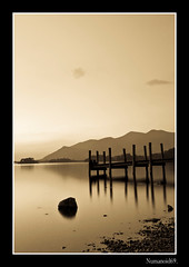 Derwent Water Jetty. (numanoid69) Tags: uk longexposure england lake mountains sepia reflections landscape pier nationalpark lowlight jetty lakedistrict cumbria fells derwentwater abigfave almostanything nikond300 thebestofnikon goldenmasterpiece prideofengland