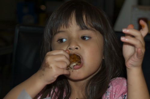 Mina eating buffalo wings