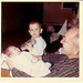 John Henry Shenk holding Jennifer Hubbard at one week old  Stuart is holding the bottle. - Jan 1963