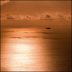 Suncopter (ecstaticist) Tags: ocean light canada reflection water silhouette vancouver sunrise de island gold flying glow bc juan ripple pass wave victoria aerial sparkle helicopter commute passing blade straight hdr blades strait topaz adjust sikorsky fuca tonemapped tonemapping heliject