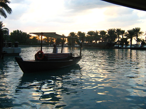 A water taxi in the sunset