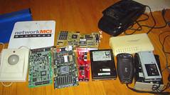 20090118 - cleaning house - 174-7494 - mousepads, trakball, computer cards, harddrives, vhs rewinder, hub, webcam, microcassette recorder - by Rev. Xanatos Satanicos Bombasticos (ClintJCL)