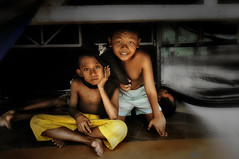 Losari Beach, Makassar - Life under the Stage (Mio Cade) Tags: poverty street travel boy portrait sun hot beach boys kids night children indonesia evening kid interesting asia day child sad risk sleep stage homeless group poor photojournalism structure beggar help shelter temporary sulawesi streetchildren soe beg scourge makassar losari streetboy flickraward