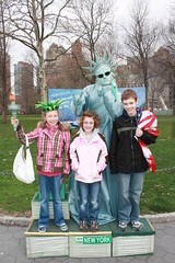 Nate, Maddie and Em in Battery Park with Statue of Liberty