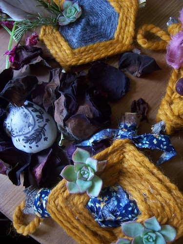 twigs, yarn, petals and a rock