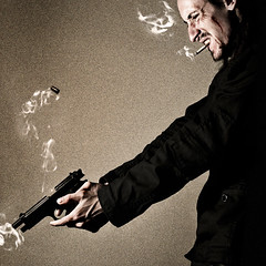 Gunfight (D A M R O W N E Y) Tags: shells selfportrait blur colour texture composite digital dark fire death concentration fight gun action shots cigarette smoke grain slide gritty smoking sharp explore squareformat violence shooting veins grainy scar beretta hitman sharpness recoil adamrowney