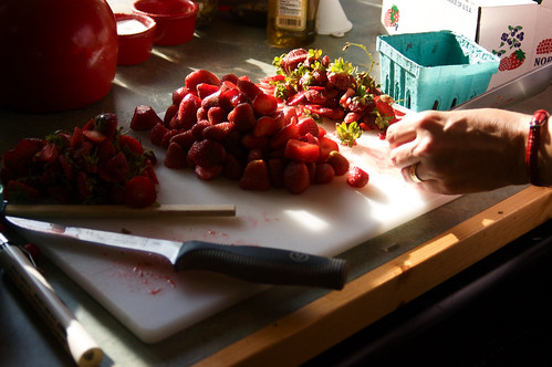 preparing strawberries for jam