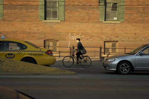Girl on bike at Bathurst and King