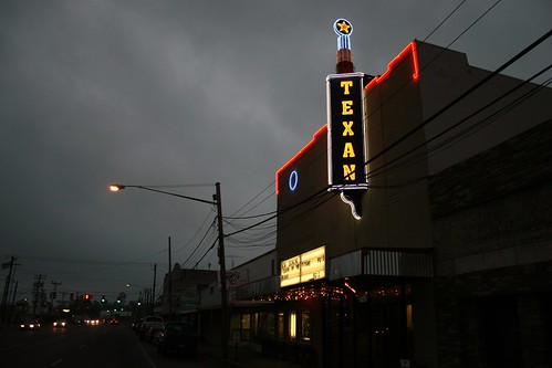 texan theater lit up at night