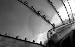Airstream Detail (greenthumb_38) Tags: blackandwhite bw vintage blackwhite stainlesssteel rivets duotone trailer airstream stainless traveltrailer jeffreybass canong11