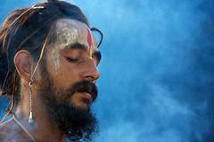 Deep in Meditation (© Poras Chaudhary) Tags: blue portrait india smoke haryana kurukshetra yagya yagna tilak nagasadhu yajña brahamsarovar solareclipsefair