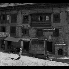 Two Kids in the morning, bhaktapur (Nepal) (Sukanto Debnath) Tags: street morning nepal boy bw white black heritage girl kids children woodwork asia sony running playful f828 bhaktapur debnath sukanto sukantodebnath