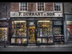 Ye Olde Shoppe (Roger.C) Tags: window shop canon fishing shoes dusk sigma guns hdr worcester tonemapped