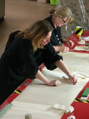 Conservators working on the Bayeux Tapestry photograph, February 2009.