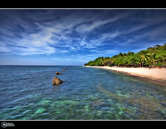 The other side | Explore (rev_adan) Tags: park lighting blue trees sea summer sky sun white seascape hot green beach water clouds canon landscape eos sand perfect rocks waves skies photoshoot angle stones philippines wide wideangle explore midway pure frontpage seashore ultra mindanao submerge uwa canon1022mm initao 40d revadan garbongbisaya