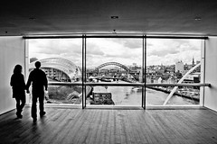 Love's Window. (Ian McWilliams.) Tags: love window couple view baltic gateshead tynebridge milleniumbridge swingbridge newcastleupontyne rivertyne thesagegateshead blackwhitephotos thesagebuilding