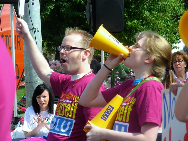 John Aronno and Heather James marching with ACLU & Equality Works