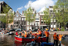 Koninginnedag 2010 Amsterdam - Houses on canal (Fabi Fliervoet) Tags: birthday family houses party music orange holiday holland beer dutch amsterdam 30 boats togetherness boat canal dance costume dancing market unity stock thenetherlands royal parties canals queen clothes celebration national april concerts juliana craze festivities crowds herengracht 2010 queensday koninginnedag nationalholiday wilhelmina pand freemarket april30 april30th koningin wilhemina fabifliervoet
