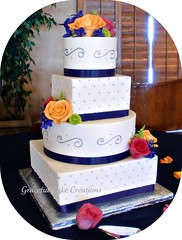 Elegant Blue and Ivory Wedding cake (Graceful Cake Creations) Tags: flowers blue autumn wedding roses party summer white fall classic cakes rose cake diamonds silver garden gum square shower moments blossom designer antique anniversary unique paste traditional blossoms navy cream ivory polka diamond rosebud special celebration polkadots reception butter round romantic ribbon cinderella elegant bridal custom jewels occasion couture autumnal scroll stacked metalic fondant buttercream scrolls gumpaste dragee dragees sprayrose blueweddingcake cinderellaweddingcake navyblueweddingcake whiteandblueweddingcake silverandblueweddingcake gr