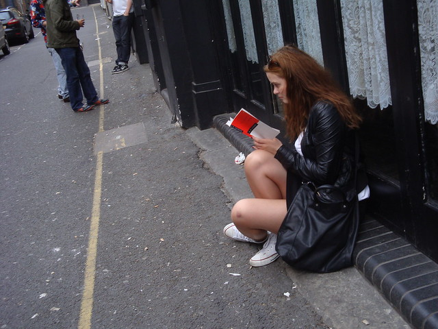 Woman reading on the street-2