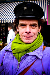 Captain ROB.... (zilverbat.) Tags: leica portrait man holland male colors dutch face lumix close artistic panasonic portret jas vignetting puch sjaal oorbel lx3 puchclub zilverbat kouweklauwen rjbongers