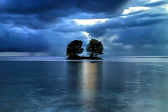Lost in blue (Kaoscube) Tags: ocean africa blue trees sea sky reflection beach water alberi clouds landscape island twilight paradise nuvole mare open wide dream stormy cielo seychelles acqua spiaggia hdr mystic paesaggio enchanted paradiso sera oceano isola riflesso ladigue mistico colourartaward kaoscube