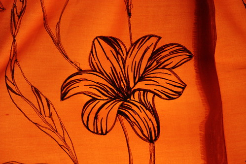 Black flower on orange background