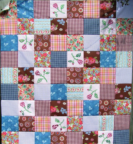 Quilt with embroidered tablecloth