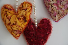 perfumed hearts (Pepa Amenabar) Tags: roses ribbons pearls hanginghearts driedpetals