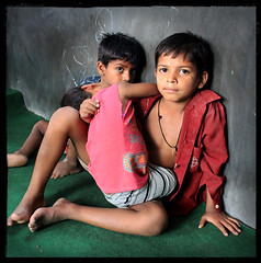 Mastery of Fear (designldg) Tags: boy portrait people india eye boys childhood dedication youth children square hope education child respect emotion expression faith atmosphere happiness help soul hero varanasi guria strength brotherhood humanrights dharma yuva courage benares benaras uttarpradesh  indiasong canoneos500d