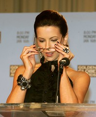 Kate Beckinsale puts on her glasses (GwG Fan) Tags: glasses girlswithglasses katebeckinsale rimless plusies pluslenses
