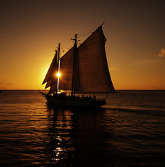 Sailboat & Sunset Eclipse (Edgar Barany) Tags: trip travel sunset sea usa sun water yellow sailboat us nikon florida miami south sail tropic keywest d200 vacations 70200mmf28gvr nikond200 barany edgarbarany
