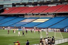 Emmanuel Osei (5) clears a ball