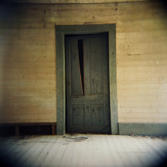 Escaped (evanleavitt) Tags: county door wood blue light shadow 2 house abandoned 6x6 film home broken rural ga georgia holga darkness decay atmosphere it scan spooky 400 pro roll weathered medium format vs trim haint oconee 120mm 120n escaped fujicolor nonhdr