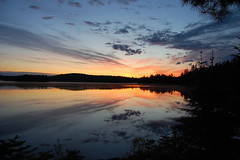 Algonquin Sunrise (GlossyEye.) Tags: world park trip camping vacation sky canada reflection art nature water beautiful sunrise landscape photography la nikon 55mm photograph fa algonquinpark peacefull trave goldengarden differenza  lamicizia nikond40  lamiciziafaladifferenza