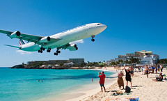 Air France over Maho Beach 2 (Arian Durst) Tags: ocean cruise people beach beautiful danger plane airplane island saintmartin crazy amazing scary dangerous sand paradise turquoise watching jet surreal stmartin tropical sunsetbeach caribbean arrival stmaarten airbusa340 jumbojet sxm spotting airfrance sintmaarten netherlandsantilles bystander rccl rci mahobay closecall mahobeach princessjulianainternationalairport frenchwestindies lowflying airplanelanding royalcaribbeancruiseline dutchwestindies