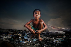 Steung Meanchey, Phnom Penh - Chai and his treasure (Mio Cade) Tags: poverty boy shirtless sun hot glass shirt site kid dangerous garbage cambodia child risk treasure cut poor environmental dump social sandal chai phnom scavenger penh barefooted steung meanchey