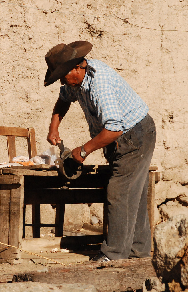 Sharpening a knife, the old fashioned way, Tastil, Argentina