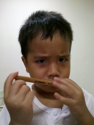 Julian sniffing pencil