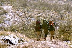 Backpackers skipping down the trail to find the Lost Dutchman's gold - Tortilla Trailhead - Superstition Wilderness