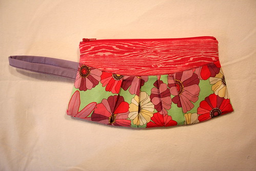 Floral wristlet with hot pink wood grain