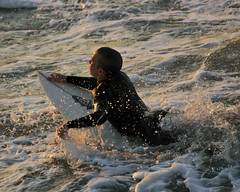 Emerging light (ScottS101) Tags: california ca light boy sunset male beach wet water cali youth gold golden warm surf waves surfer huntington wave surface spray spuma teen foam surfboard olas magichour hombre goldenhour homme grom emerge surfacetension surfista duckdive