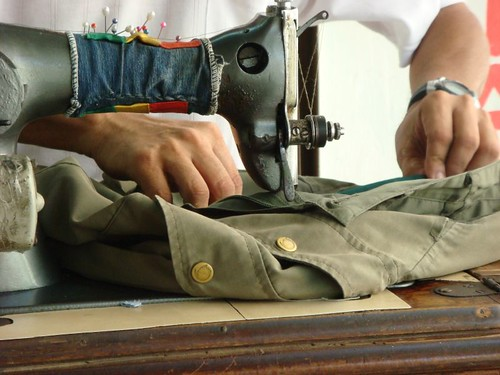 The local tailor fixing my worn pants in Cartagena...