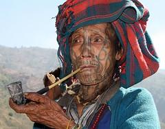 A Chin lady smoking pipe (florian_grupp) Tags: woman face tattoo lady rural costume colorful asia southeastasia skin native burma traditional pipe tribal smoking weathered myanmar southeast tribe birma chin mun facetattoo chinstate tattooedface chinbok