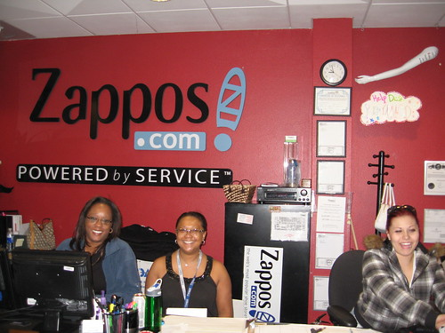 zappos reps in front of a zappos sign