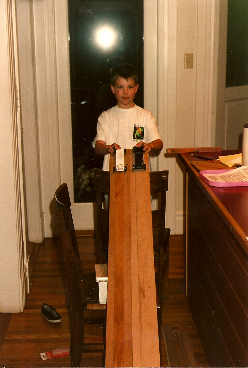 Taylor and his Pinewood Derby cars