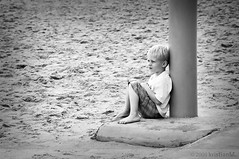 Beyond (kristian.eric) Tags: boy portrait blackandwhite bw beach monochrome kid still sand child thoughts solo portraiture contemplate