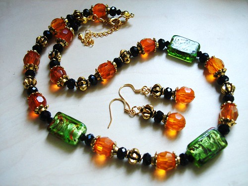"#GBN087+E = ALWAYS SWEET  Glass Beaded Necklace N+E Set $35 = Green Foil  Glass Beads , Tangerine Orange Czech Glass Beads , Black Rondelles and Antique Gold Plated Metal Findings. Necklace measure about 16-18"" in lenght with 2 "" extension chain / earrings Approx about 4-5cms including hooks."